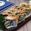 Dragon Avocado Roll (320.-)