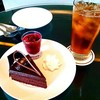 Chocolate  fudge cake with iced tea