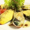 Baked Blue Mussel on Spinach with Cream Cheese and Hollandaise Sauce