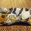 yoghurt chaat, samosa, spiced nut in an edible plastic bag, Pani Puri