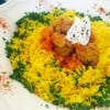 Spiced beef meatballs in tomato sauce, served with Turmeric rice
