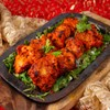 Boneless chicken marinated with yoghurt and spices grilled in Tandoor Oven.