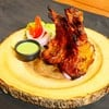 Lamb Chop Marinated with red chilli paste yogurt mixture cooked in tandoor