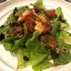 Parma Ham Wrapped Tiger Prawns with Romaine Lettuce Olives and Confit Tomato Sal