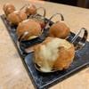 Homemade Italian deep-fried dough balls topped with vanilla custard sauce