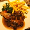 Grilled Pork Chop with Mushroom sauce.