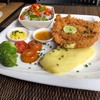Crispy Schnitzel served with Mashed Potatoes and Salad Delivery 062-4387373