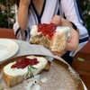 Whipped ricotta and jam on herbs toast