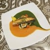 Grilled salmon and sea bass in spinach and chilli gravy