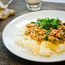 Crusty flat rice noodles with wok fried minced chicken with hot basil
