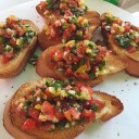 Bruschetta with yellow and red cherry tomatos