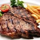 สเต็กเนื้อวัวติดกระดูกราดซอสพริกไทยดำ