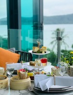 Upgrade your day with an afternoon tea experience at My Lounge. Sip on a cup of freshly brewed coffee or tea and indulge in savoury and sweet delicacies. All are within the comforts of our sumptuous sofas and mesmerizing beach views. Among the highlights are Phuket-style braised pork belly cones, salted egg bean macarons, and coconut pandan crepes.  The afternoon tea set at My Lounge is available daily from 15.00 - 17.00 hrs and is priced at 690 Baht per couple.   For reservations, please call 076 305 066-069.