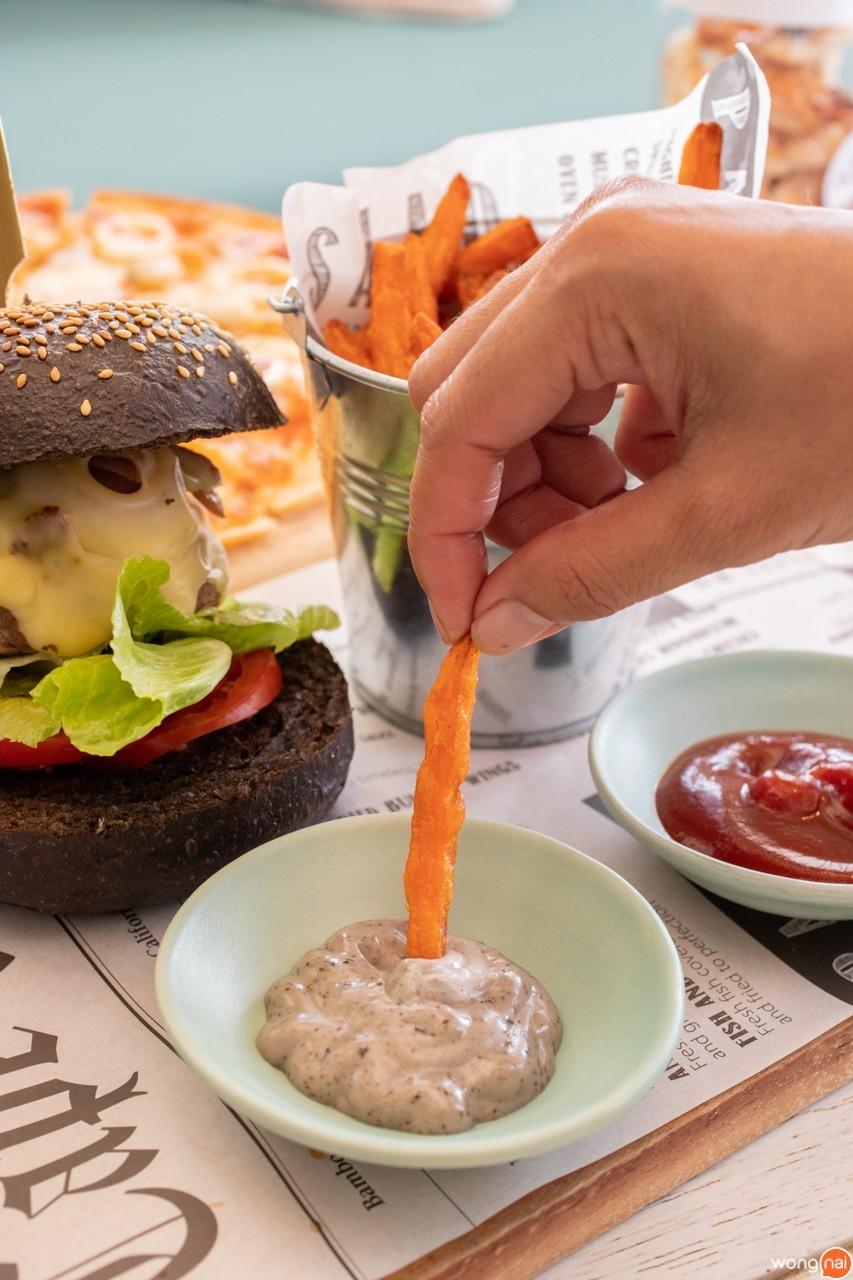 Black bun cheese burger with sweet potato fries