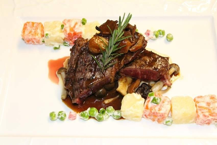 Grilled Wagyu Rib Eye Steak with Potato Salad and Cepe Mushroom Gravy