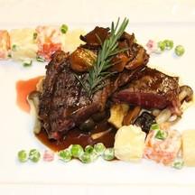 Grilled Wagyu Rib Eye Steak with Potato Salad and Cepe Mushroom Gravy