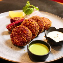 Beetroot patties stuffed with apricot ,deepfried served with mint sauce