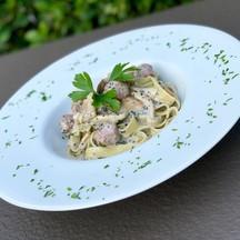 Fettuccine with Italian sausage, sauteed mushrooms, parsley, and truffle cream