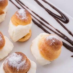 Home-made Cream Puff with Whipped Cream and Chocolate on the Top