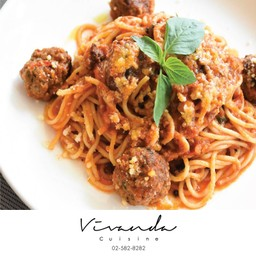 Spaghetti with lamb meatballs in spicy tomato sauce
