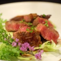 B22 วากิว ริบอาย A5 ย่าง ราดซอสมิโซะแดง (ร้าน - TATSUMI Japanese Cuisine)