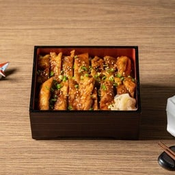 Pan-fried chicken with buttered teriyaki sauce on rice