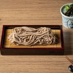 Chilled udon or soba noodles served with soy based dipping sauce