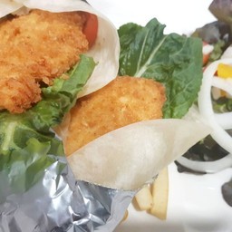 Breaded chicken Fillet Wrap Served with Salad & French Fries