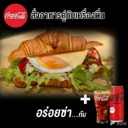 Fried Egg and Cheess Croissant with Coke