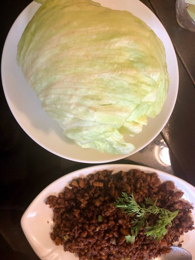 Minced duck meat served with fresh cabbage