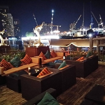 Outdoor area with a night view of Chao Phraya river