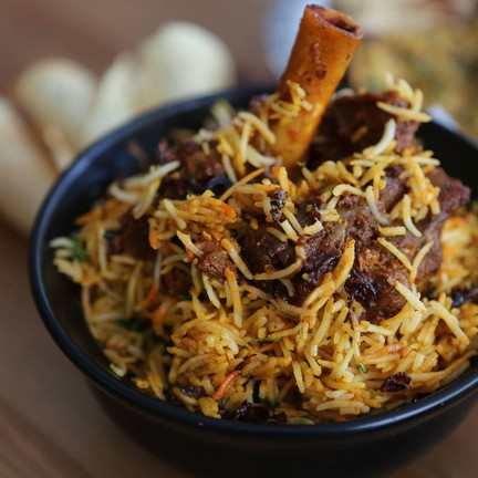 Traditional Biryani cooked in seal pot with Lamb
