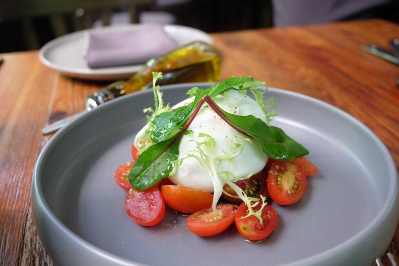 Burrata from Puglia with mixed heirloom tomato and Sicilian extra virgin olive oil